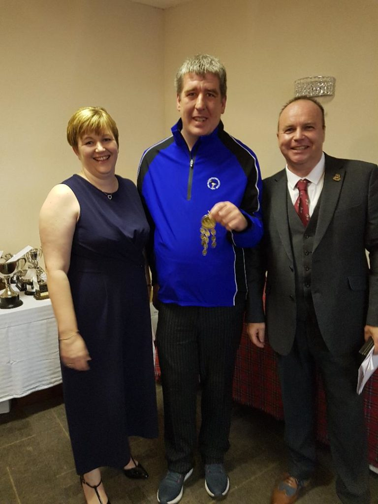 Willie Ross and his wife Kirsteen present Dean Ratcliff, centre, with the spring meeting gold medal.