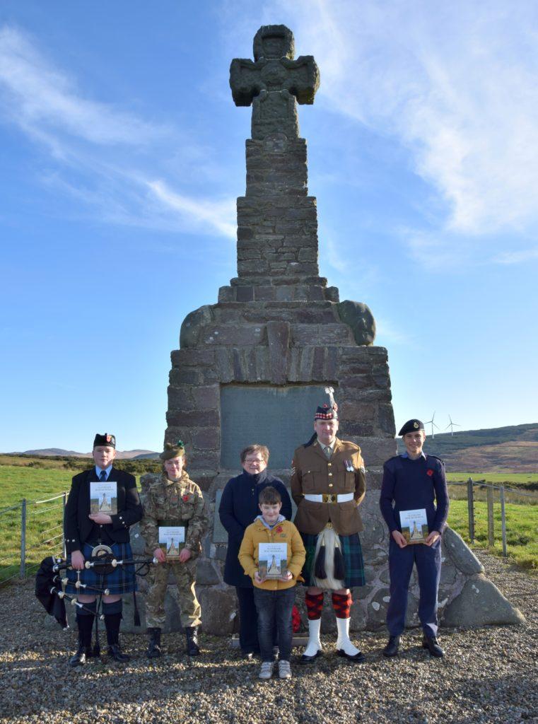 From left, piper Calum O'Hanlon, army cadet Jennifer McMurchy, Marion McDonald standing behind Jake Rowan, Colour Sergeant Robbie Semple and sea cadet James Reid.
