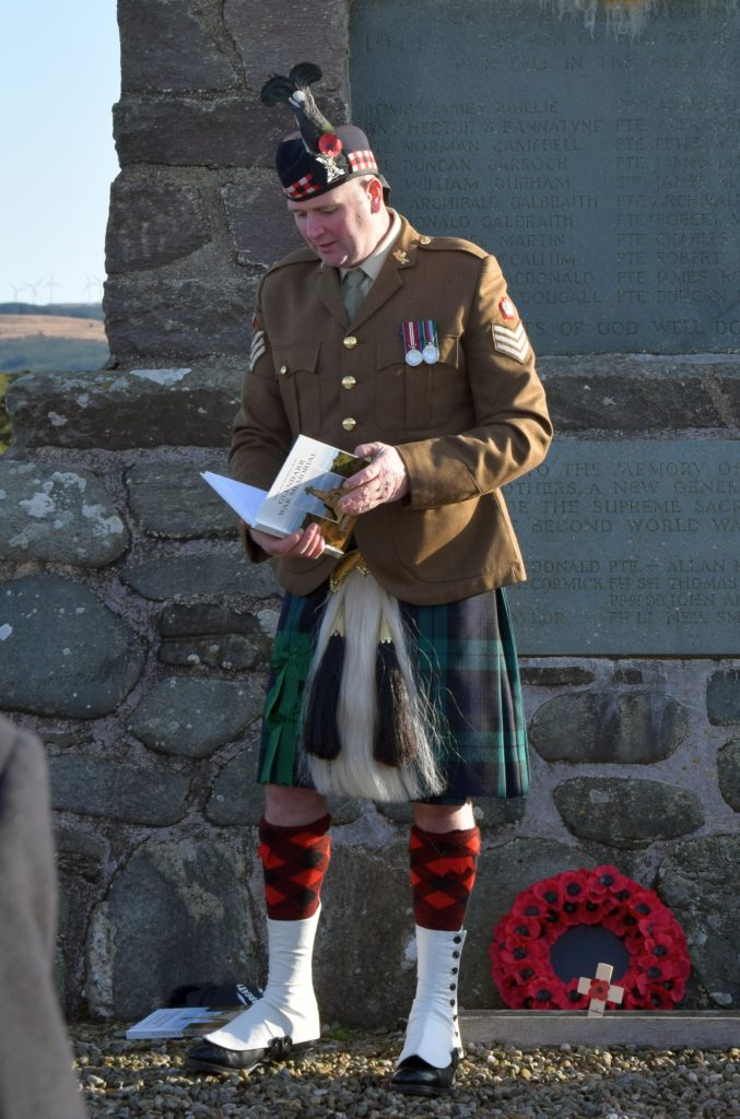 Colour Sergeant Robbie Semple, chairman of Glenbarr War Memorial, presented copies of the memorial book to the youngsters who took part in the service.