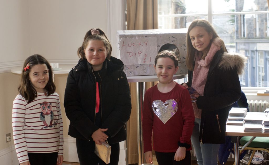 Amy Macpherson, Ella McGeachy, Cara Macpherson and Ivana Mati had a go at the lucky dip stall.
