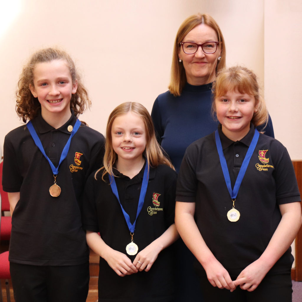 The second placed junior ensemble, Campbeltown Brass A's Cara McFadzean, Gemma McCaig and Emma Oman. Annie Watson is missing from the photograph.