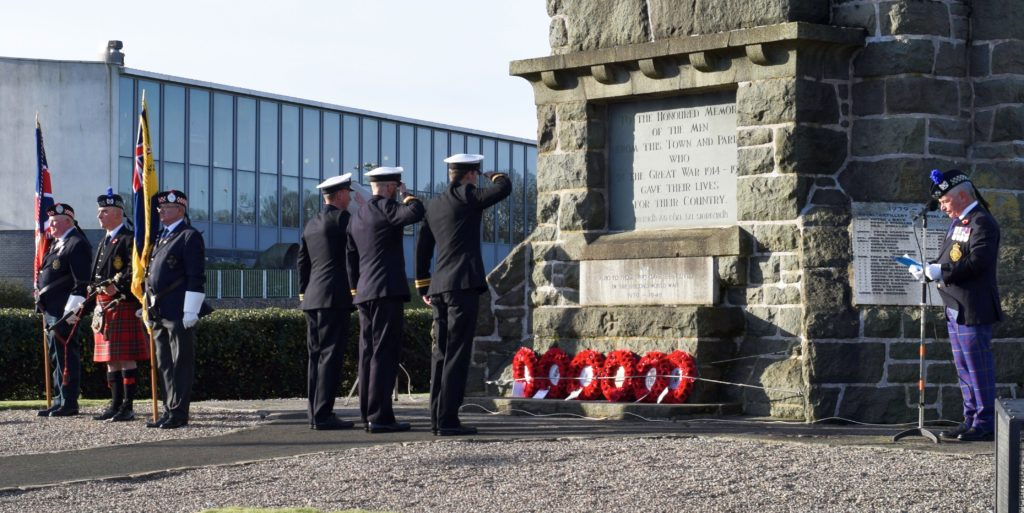 Navy officers placing wreaths at the foot of Campbeltown War Memorial are Lt Cmdr Matt Ellicott form HMS Chiddingfold, Lt Cmdr Peter Ellison from HMS Ramsey and an officer from HMS Argyll. To the right stands George Rahman, chairman of RBLS Campbeltown branch, and to the left are branch standard bearers Jimmy Robertson and Billy Morran, and the branch piper, John McGeachy.