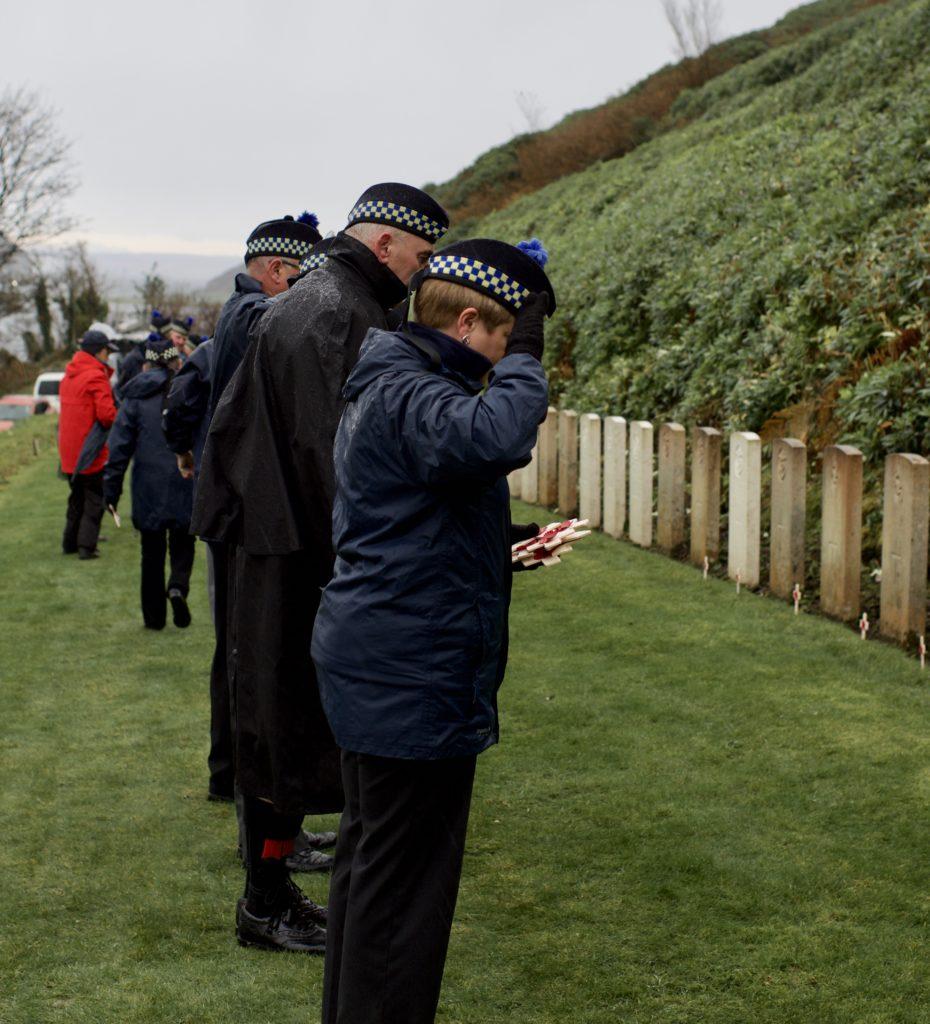 Irene Rahman, ex Royal Air Force, piper John McGeachy and Jimmy Robertson lay poppy crosses at Kilkerran Cemetery's Commonwealth War Graves.