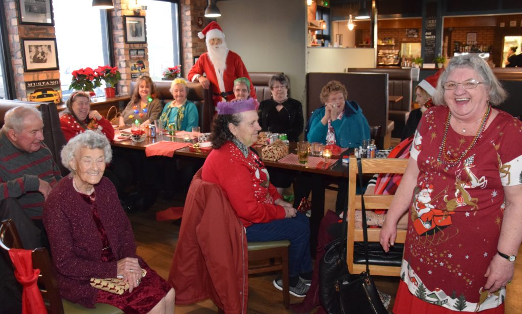 Members of the Monday Social Club celebrated with Santa at their annual Christmas party.