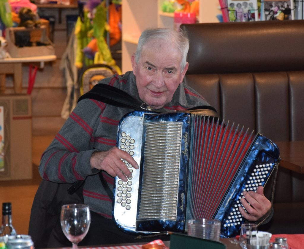 Alec MacKinnon entertained with his accordion.