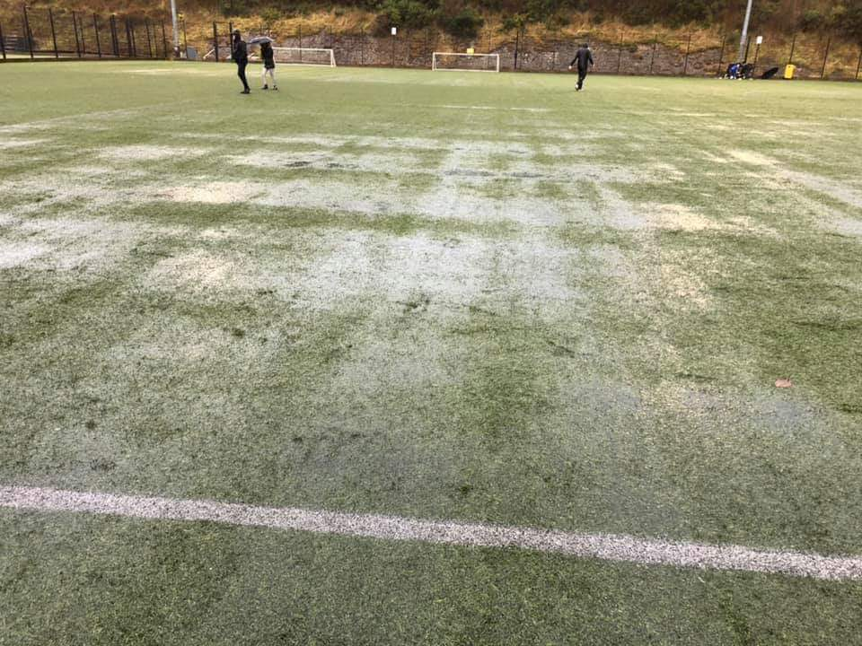 Slippery conditions led to the secretary and coaches' decision to pull the young players off the synthetic pitch.