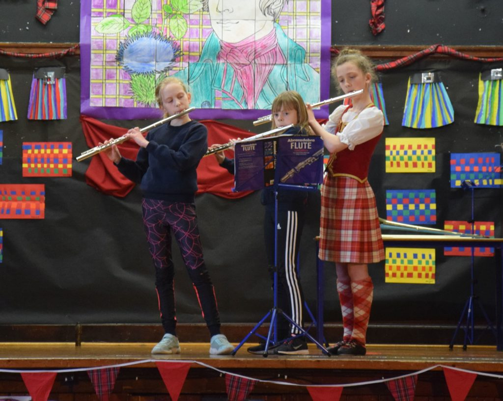 Flautists Annie, Gemma and Cara.