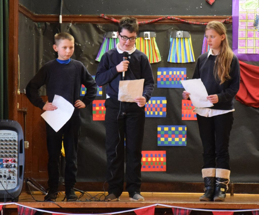 Brandon, Charlie and Morgan read poems to the audience.