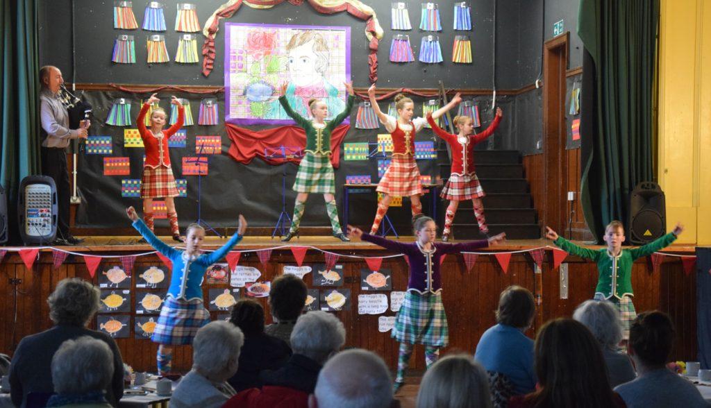 Senior Highland dancers perform.