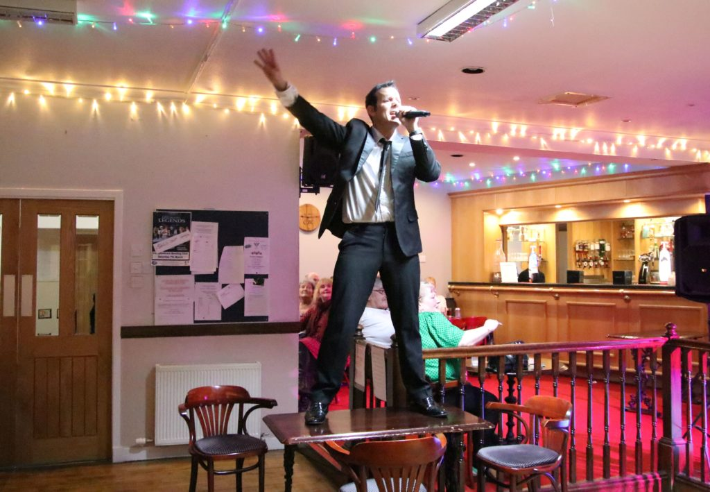 Many of the tributes, including Michael Bublé in this photograph, performed on top of the tables.