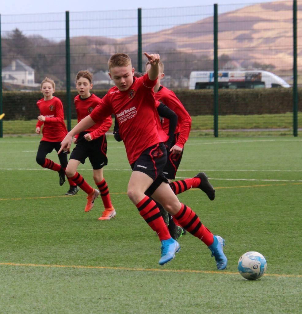 Calum McAllister keeps an eye on the ball during the match on Sunday.