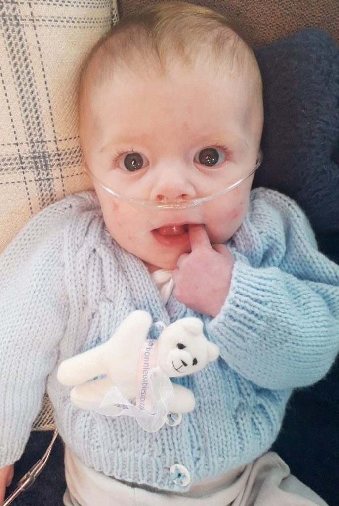 Little Orion wearing one of the knitted cardigans which came from the Campbeltown charity.