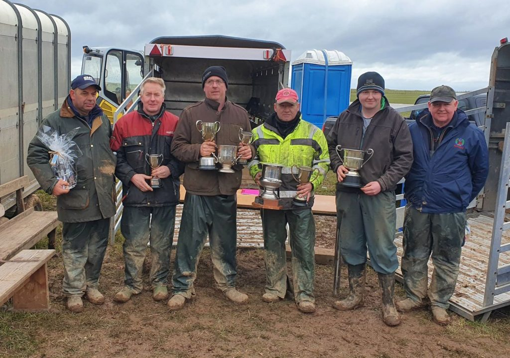 The cup winners with judges Colin Crawford, left, and John Walker, right, are: Ian Barbour, Fraser Woodrow, Michael Mayberry and Robert MacDonald. Photo: Catherine Reid.
