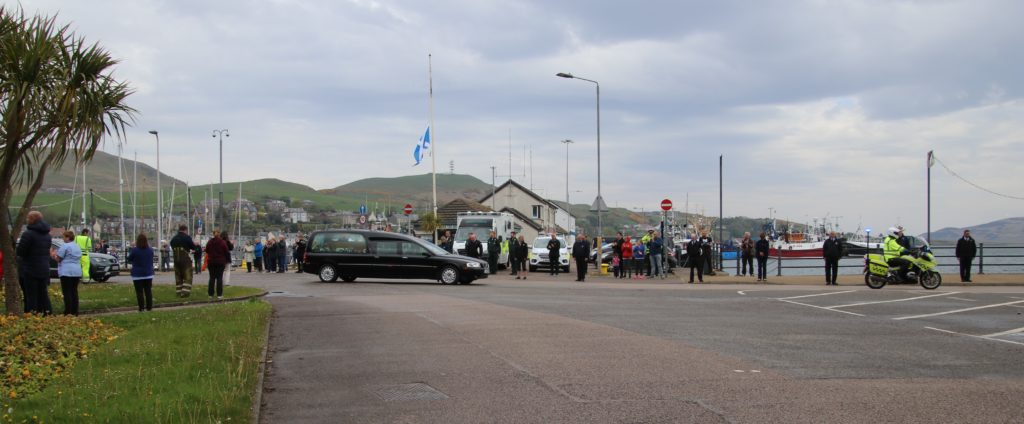 People lined the streets as Robert's funeral cortège passed through town.