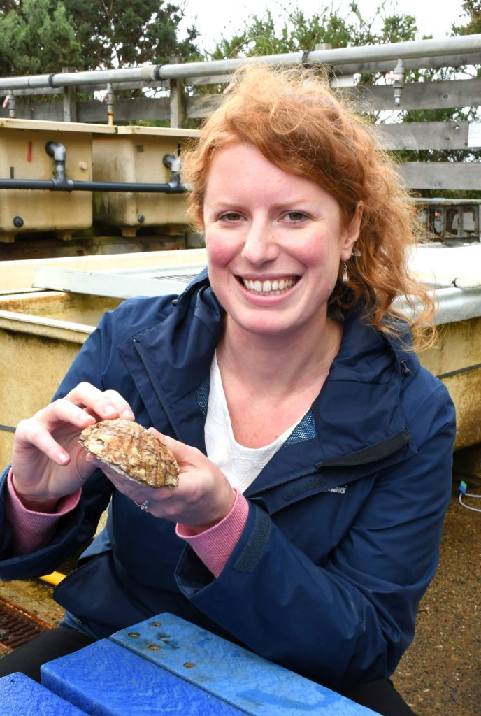 Dr Mairi Cowan with a native oyster in the Alan Ansell research aquarium at SAMS.