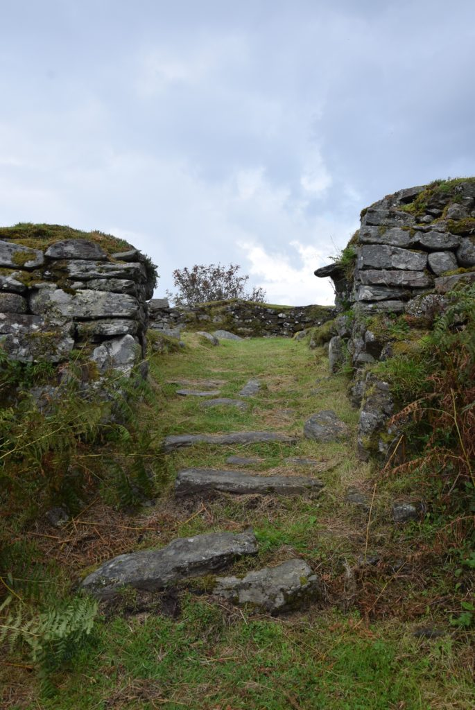 The entrance to the dun is imposingly lined with stone, and comes complete with a setting for a wooden door and slots for a beam to secure it in place.