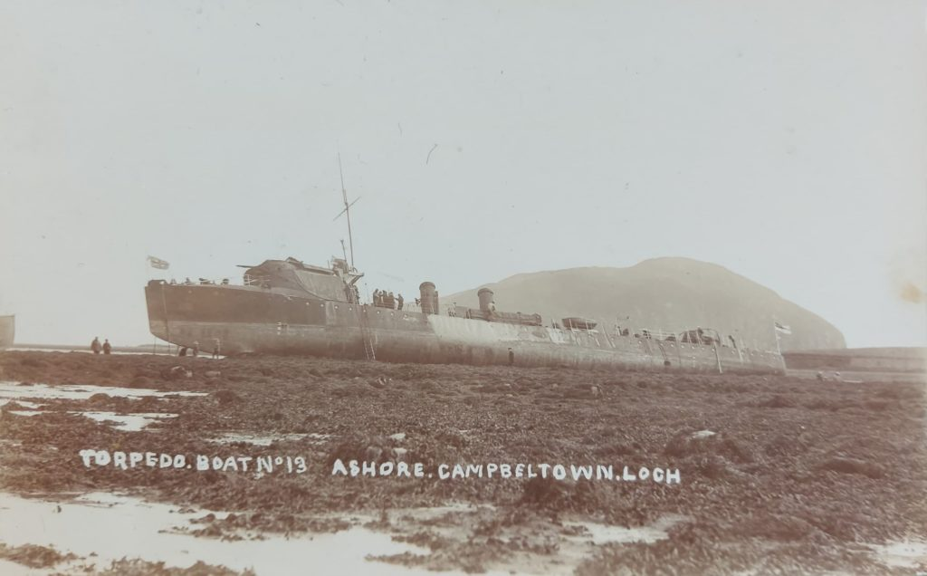 The caption on this postcard reads: 'Torpedo boat no 13 ashore, Campbeltown Loch.' The date hand-written on the back is September 19 1910.