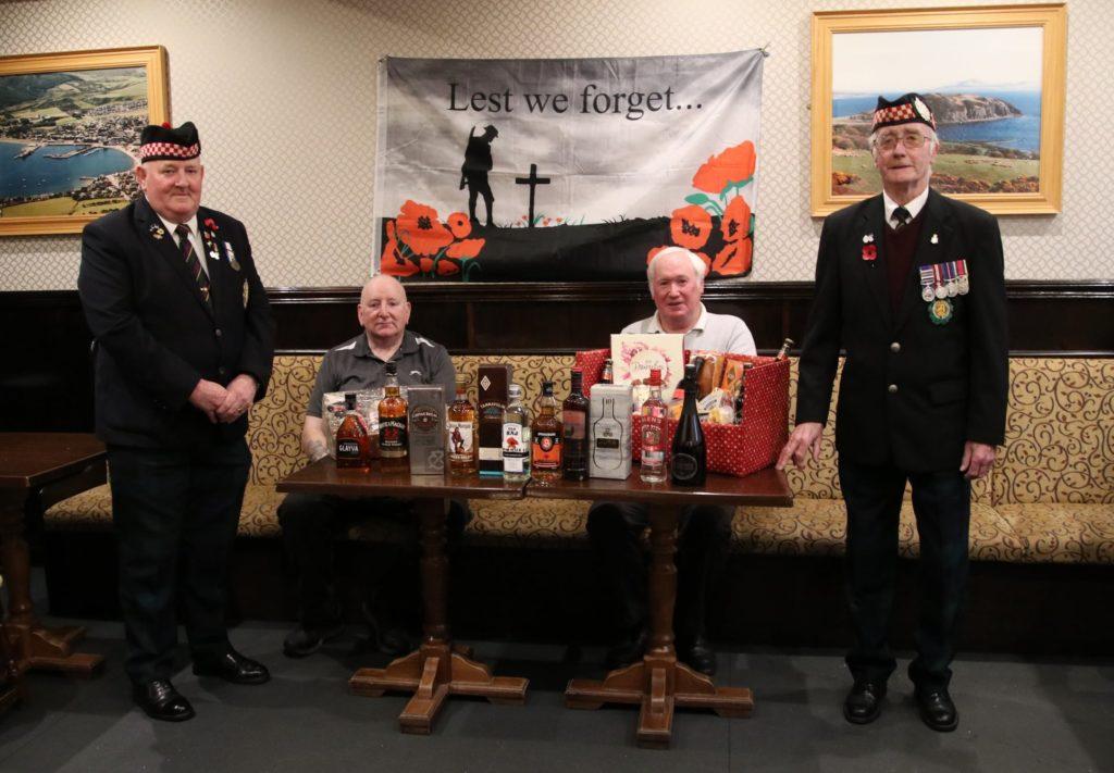 Presiding over the Kilbrannan Bar Poppy Appeal were, from left, Billy Morran, James Robertson, Donald Brown and Richard Cameron.