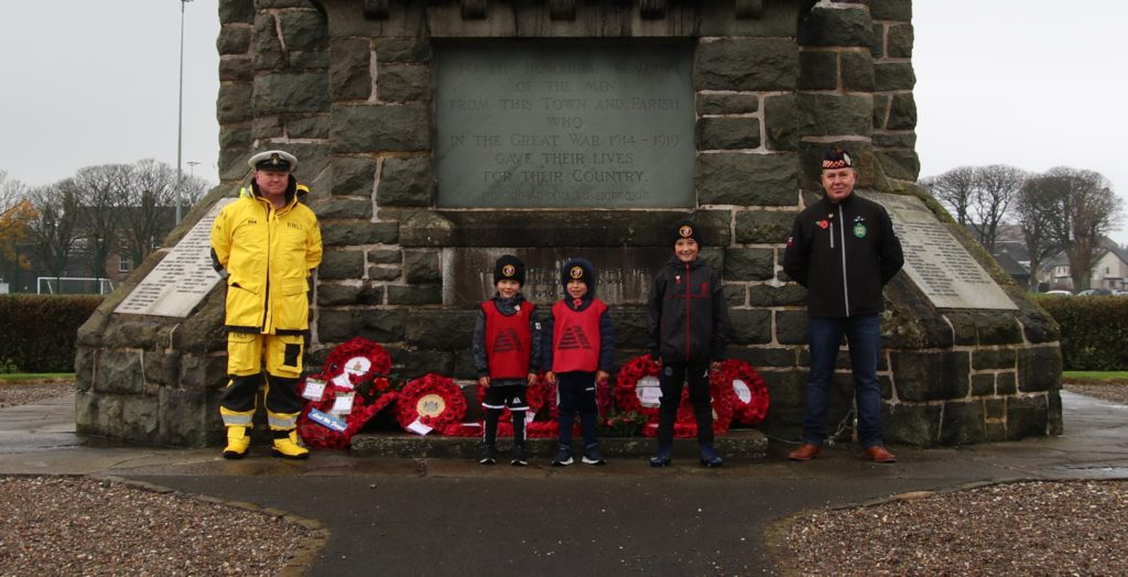 RNLI Coxswain David Cox and Harbour Master Stephen Scally were joined by their grandchildren Sonny Brown, Graham Brown and Calvin Scally.