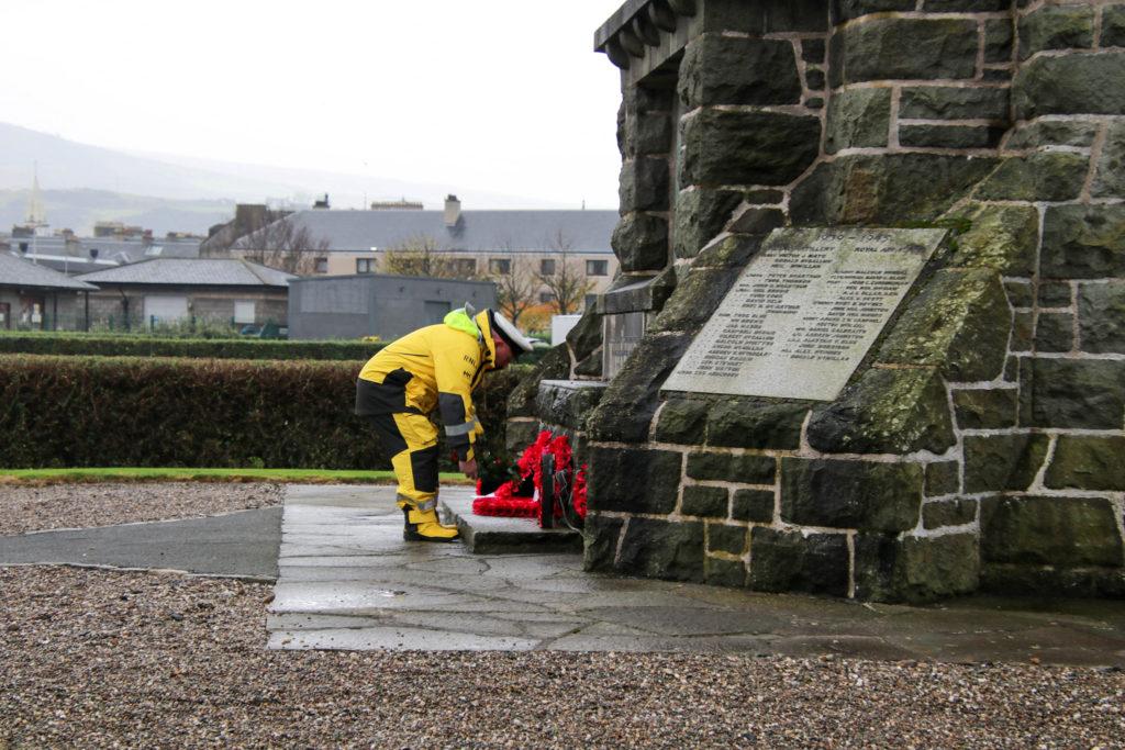 Coxswain David Cox lays the wreath on behalf of the RNLI.