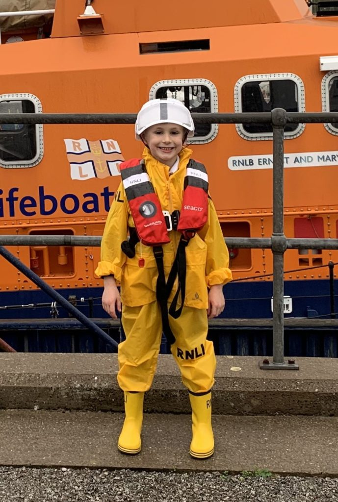John Mackenzie, aged six, from Saddell, who dressed up as lifeboat crew member and was excited to get his photograph taken beside Campbeltown RNLI's Severn Class Lifeboat.