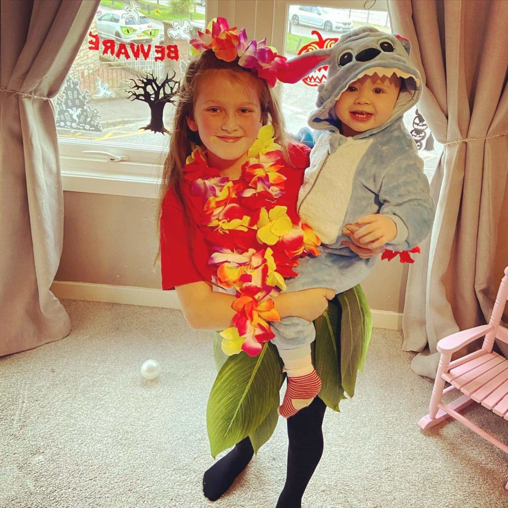 Kayla Moore, aged nine, and little sister Addison, one, from Campbeltown, as Disney's Lilo and Stitch.