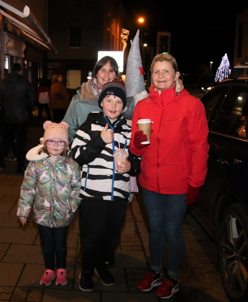 Rowan, Hunter and Karen Brodie with Eilidh Smith after the Christmas lights were switched on.