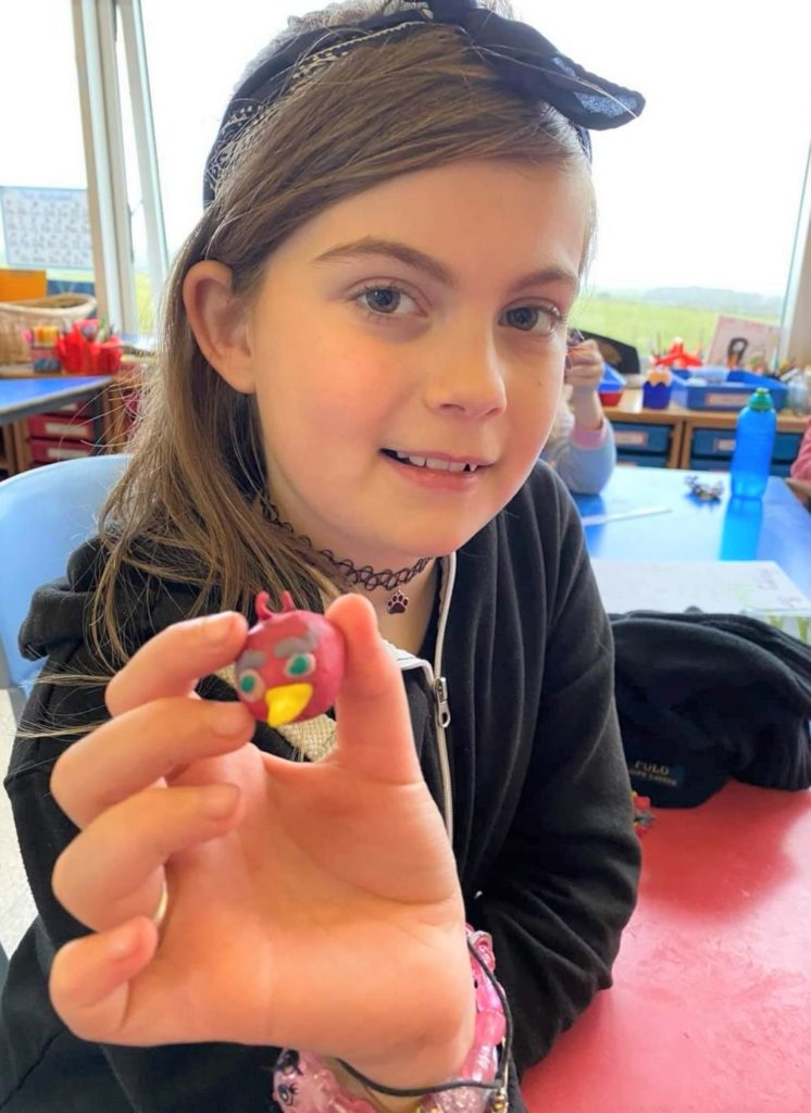 P7 pupil Tina Birtles, from Glenbarr, holding an Angry Birds 2 character she created at a follow-up modelling session.