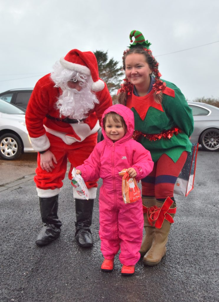 Arianna Gilchrist was delighted to meet Santa and dog Murphy.