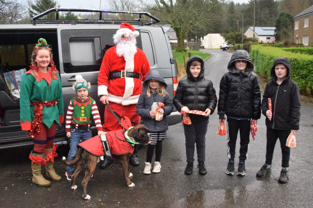 Despite the rain, children including Charlotte O'Hanlon, Stuart Byers, Mark Byers and Austin O'Hanlon, photographed here, were in good spirits.