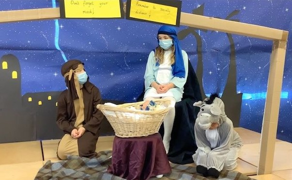 There were references to the pandemic, including signs reading: 'Don't forget your mask!' and 'Remember to socially distance!' at Glenbarr's nativity.