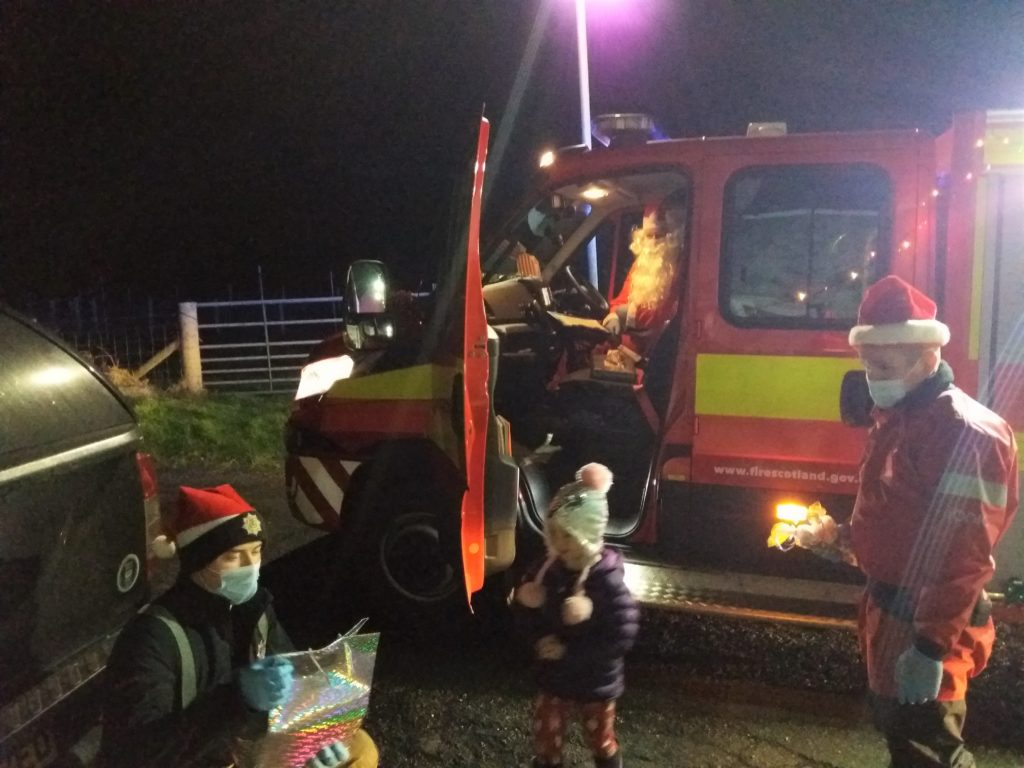 Local firemen and women helped Santa deliver presents on Islay.