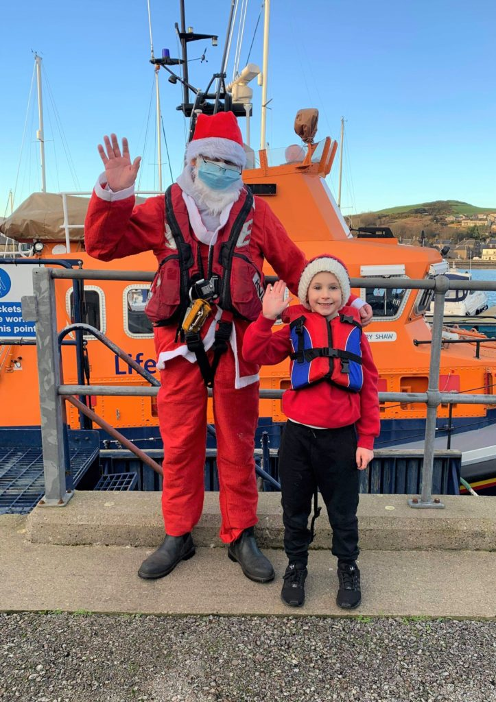 John Mackenzie enjoyed a visit to see Santa at Campbeltown's RNLI station, where he received a selection box.