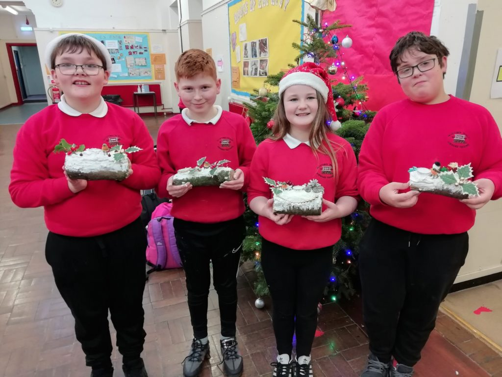 Making Christmas logs is a long-standing tradition at Dalintober Primary School and this year's P7 pupils did an excellent job.