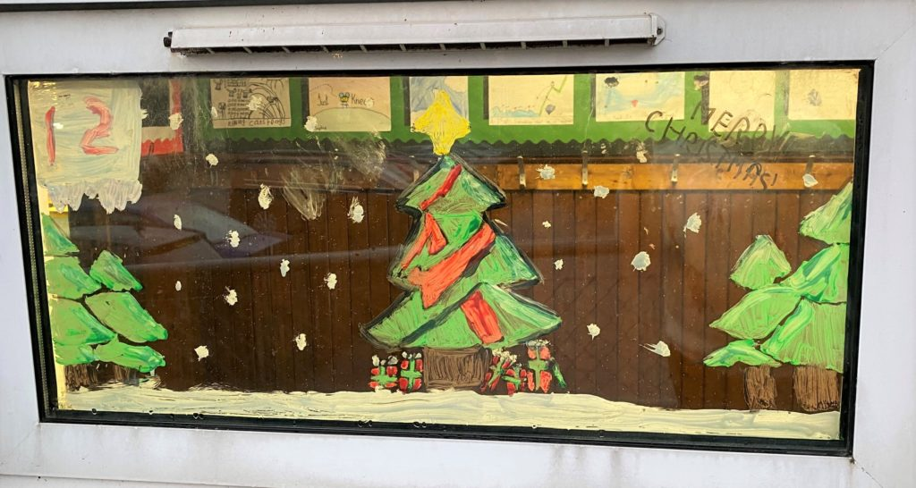 A 'Twelve Days of Christmas' window painting by P6 pupils at Castlehill Primary School.