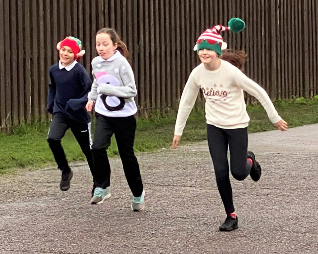 Many pupils wore festive hats as they completed the fun run.