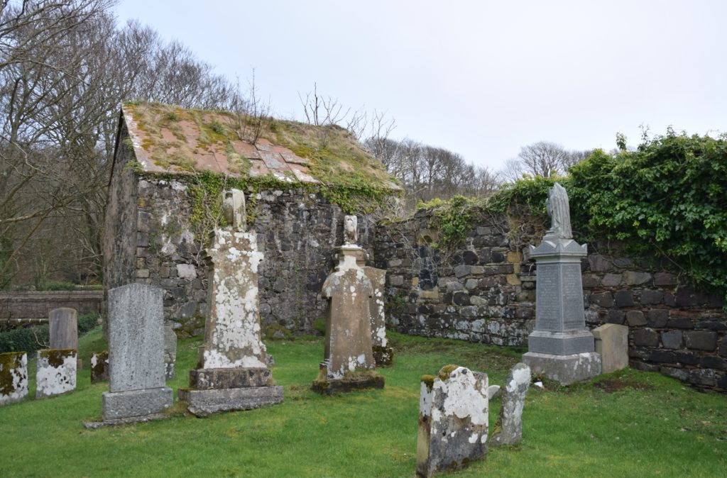 Moss grows on the roof of the Clan MacDonald of Largie family crypt.