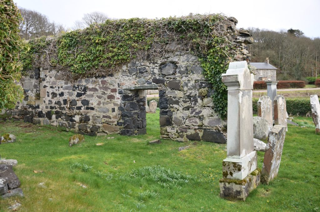 Ivy covers the walls of the now roofless kirk building.