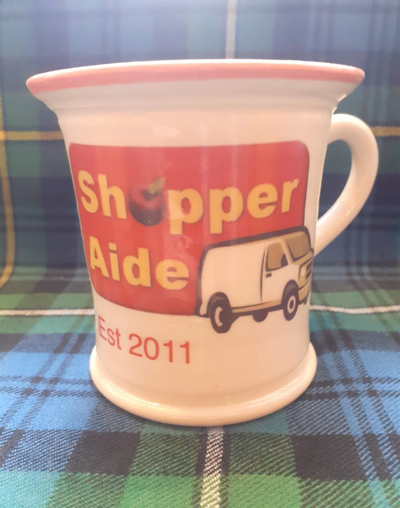 The special mug created to mark Shopper-Aide's 10th anniversary which was given to the charity's clients along this week's virtual afternoon tea goodie bags.