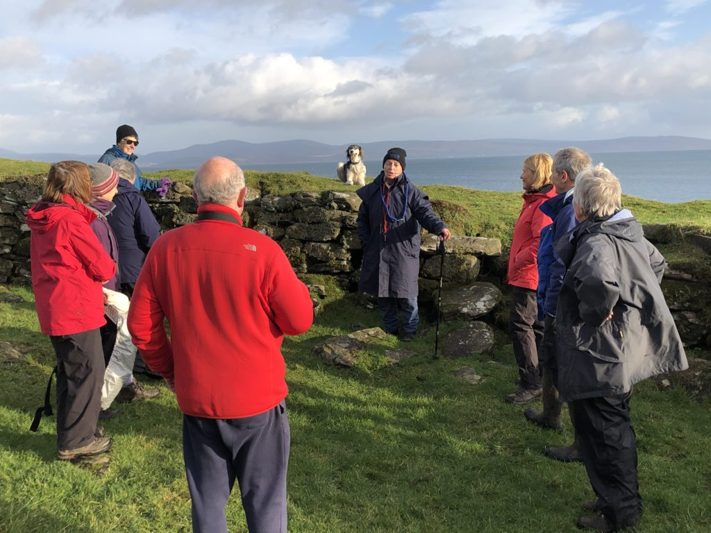 Frances Hood tells society members Elizabeth Marrison, Mike Peacock, Elizabeth MacTaggart, Ian Mitchell, Pat Healey, Hilary Lord and Catherine Dobbie about the history and excavation of Kildonan Dun.