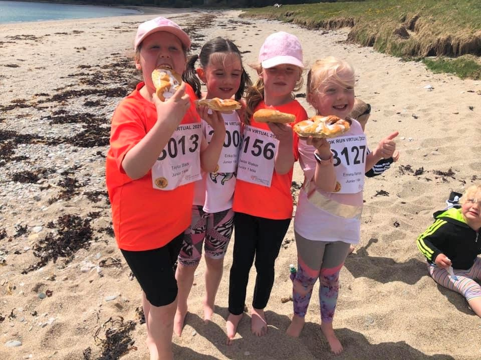 Wee pals Taylor, Erika, Maida and Emma enjoying some obligatory MOKRUN Danish pastries after completing their one-mile run on Saddell beach.
