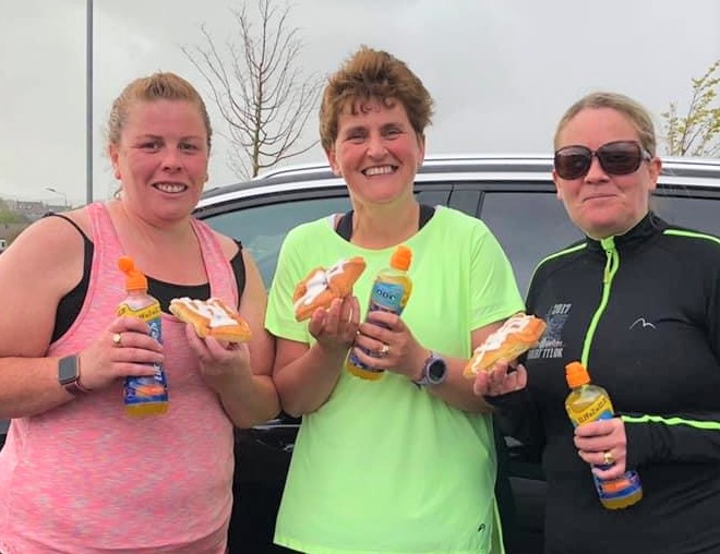 Local runners Susan Gilchrist, Audrey Willan and Lorraine Brodie enjoying their Danish pastries after completing their 10K runs.