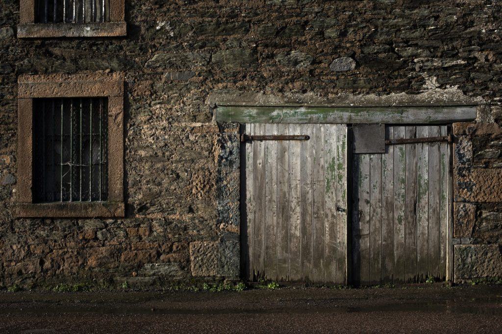 An Eternal Mark: A wooden door on a mothballed distillery building on Glebe Street exposes the enduring remnants the industry has left on Campbeltown. Photograph: Colin McPherson/Document Scotland.  Photo shows: a wooden door on a disused distillery building in Glebe Street.