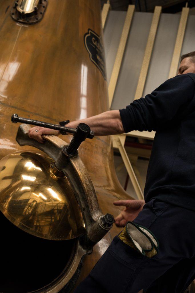 An Evocative Place: Gareth Parker, stillman, working in the original stillroom, dating back to the 1830s, at Glen Scotia Distillery. Photograph: Jeremy Sutton-Hibbert/Document Scotland.