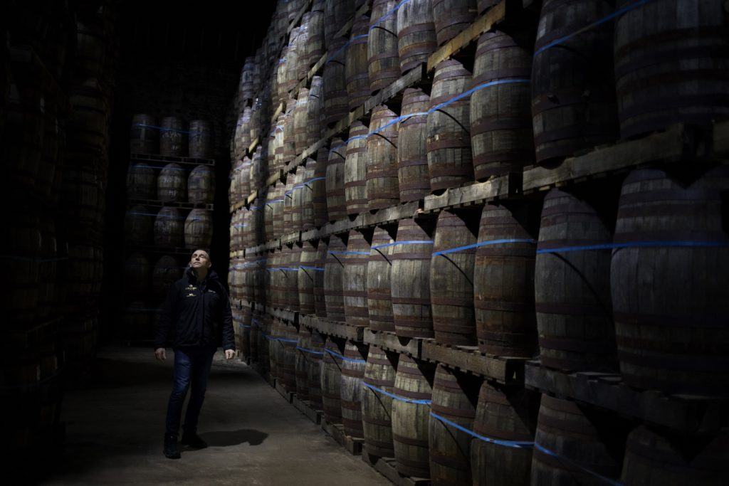 A Cathedral to Whisky: Iain McAlister, distillery manager and master distiller, tours the bonded warehouse at Glen Scotia Distillery where the sleeping casks quietly mature under his watchful eye. Photograph: Jeremy Sutton-Hibbert/Document Scotland.