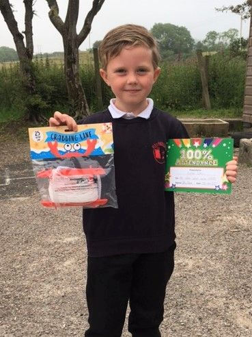 Lochlen Gibbs, who was rewarded for always being happy while learning, proudly showing his certificate for 100 per cent attendance for the session.
