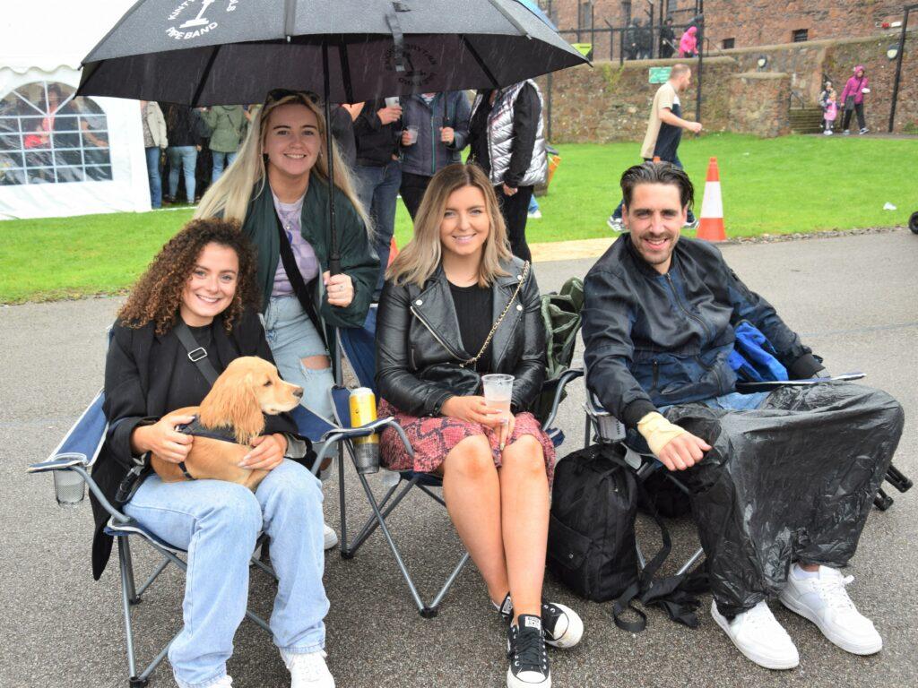 Iona Reid, holding her dog Connel, Christina McFadyen, Erin Ferguson and Calum Houston embraced Saturday afternoon's wet weather while enjoying the entertainment Up the Close.