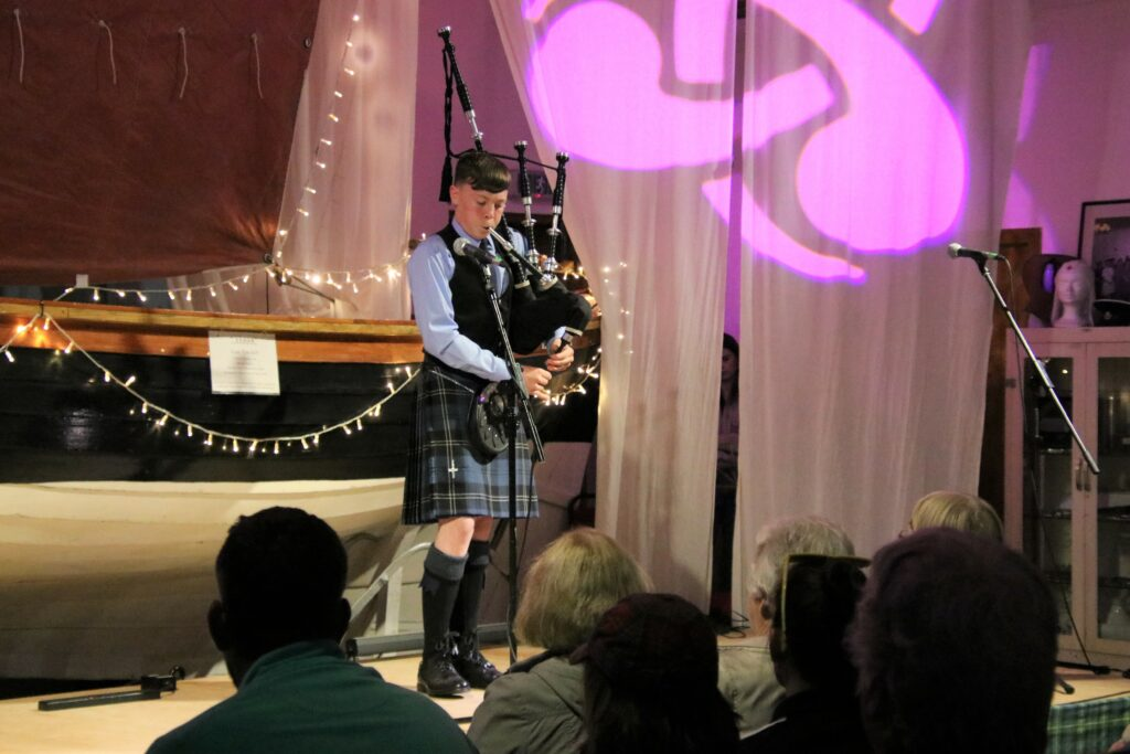 Kintyre Schools Pipe Band member William McLean piping at the Young Folk Night.