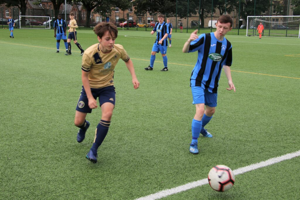 Stuart Philips, left, in action for the Pupils during the Finnart match.