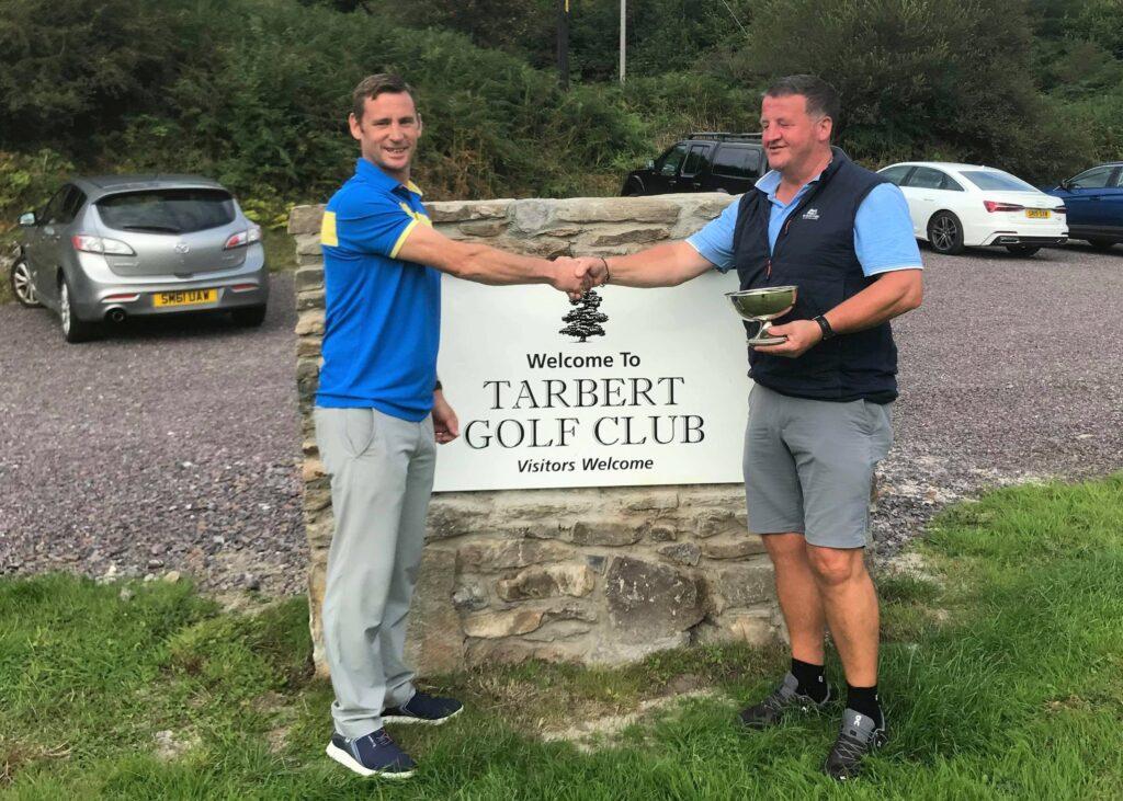 Senior champion and John Reid Quaich winner Iain Macalister with club captain Kenny MacFarlane.